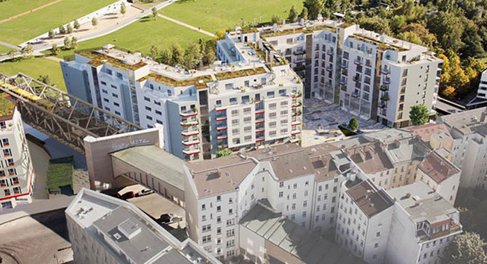 "Aerial shot of new build real estate project ""Wohnpanorama"" in Berlin-Kreuzberg, showing the condominiums in context with the surrounding neighbourhood and Gleisdreieck park."